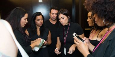 Amanda May Teaching Makeup Team at Miami Swim Week Runway Show