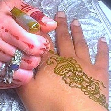 Henna application services at Island Girl uses only safe, organic ingredients.