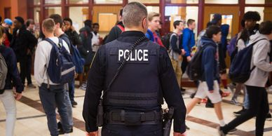 A getty image of a police officer in a school
