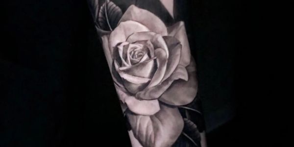 Black and gray rose tattoo by Ryan Townsend