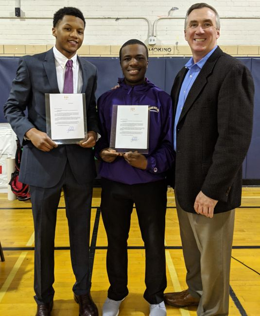 Tiger Woods congratulatory letter to Tim Arrington (l) and Abdel Raoul (c) presented by Mike Kelly.