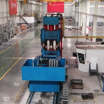 mill production machine sitting in a warehouse