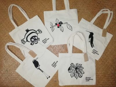 Hand-painted reusable tote bags for our travelers, as an effort to reduce the use of plastic bags