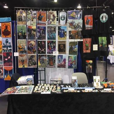 Diablo Comics' booth at Comic Con where they sell mashup up prints, stickers, jewelry and superhero related merchandise.