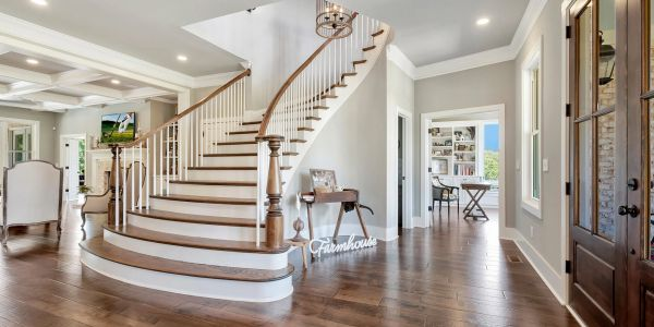 Luxury custom home foyer with curved staircase built in Georgia