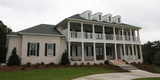 Modern farmhouse southern style plantation house new construction licensed builder in Georgia