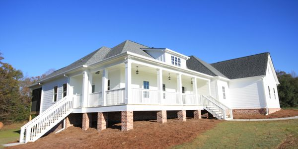 Modern farmhouse white exterior new construction licensed custom home builder in Georgia