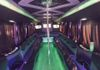 Luxury seating, seat back bars, an awesome sound system and color changing lights; Now that's a party.