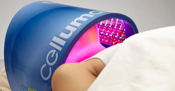 Woman laying under Celluma LED, Red  LED, Light Emitting Diode, Professional-Grade LED Device.