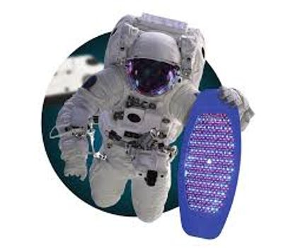 Astronaut in space suit floating in space holding a Celluma Pro LED panel.