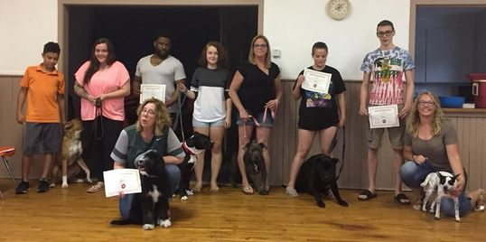 One of many graduating classes of the Classic K9 Dog Training Center's Good Dog Class.