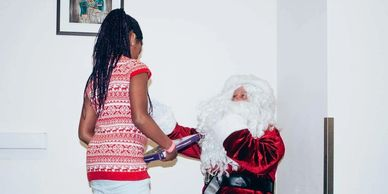 girl talking to santa