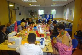 Volunteers sewing and making crafts