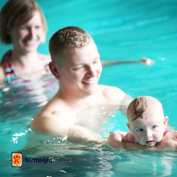 Baby and Dad Swimming