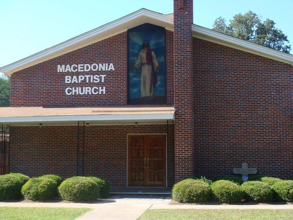 "Church front made of brick with Jesus portrait on front, says ""Macedonia Baptist Church"""
