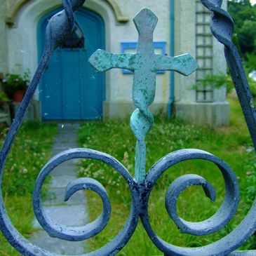 Wrought iron gate leads into an old church yard