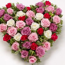 Pink and white heart funeral flowers.
