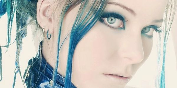 Headshot closeup of Ember Rain with blue hair in updo.