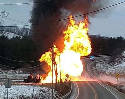 Propane tanker accident and explosion kills driver and left to burn out over several days