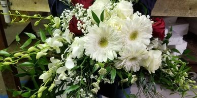 Crescent Bridal Bouquet   Contains White Gerbera Daisies, white and red roses, orchids, Italian rusc