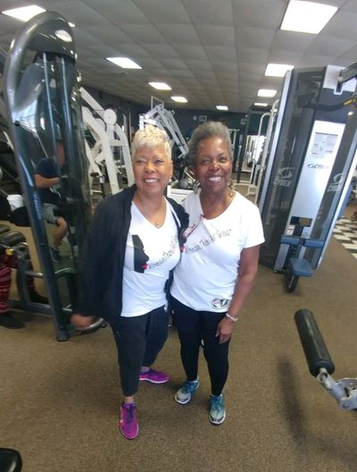 Coach Barbara and Proprietor Kathy of Kathy's Happy prepare to exercise at the River Gym at retreat.