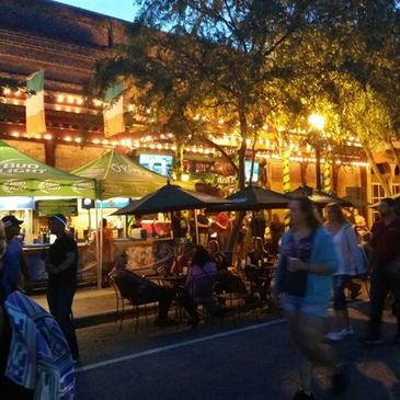 Photo of outdoor dining at a restaurant in downtown Pensacola on a monthly Gallery Night event.