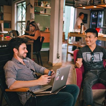 Gay couple enjoying a drink in a coffee shop.