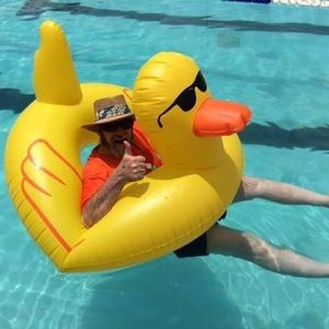 Jack Lynch in an old time bathing suit sitting in Howard the Duck huge, yellow rubber duck float.