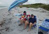 Lots of beach chairs and umbrellas, for the beach or dock.
