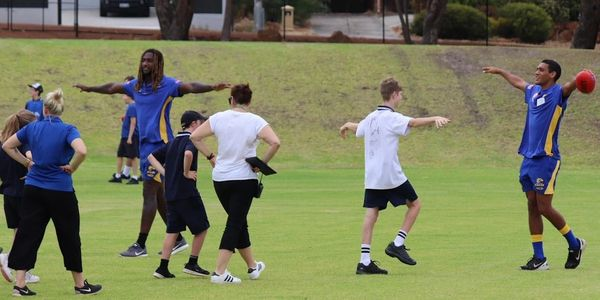 KSES students work with EAs during a West Coast Eagles training session.