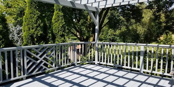 solid stained deck with pergola