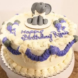 Baby Shower Cake with a Baby Elephant on Top