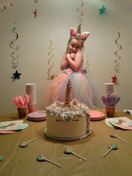 girl celebrating her birthday with a Butter Bears Cupcakery Cake