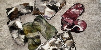 Wool Felt Mittens hand made from wool from my sheep.  Sizes small, med.,& lg.   $35 per pair.