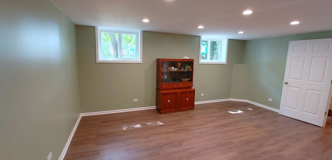 basement remodel with Benjamin Moore paint on walls, newly installed trim, installation of doors and