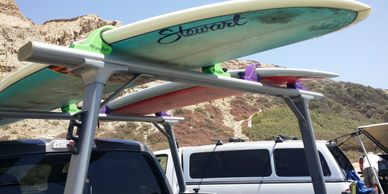 WaveRaxx surfboard racks on TracRac racks.  These WaveRaxx have been on my truck for over 5 years.