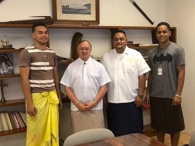 Bishop Peter Brown with Charles Asalemo, Paul Collins & Fr. Pio Afu before they departed for Panama.