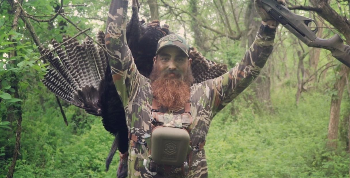 Photo of hunter with Turkey.