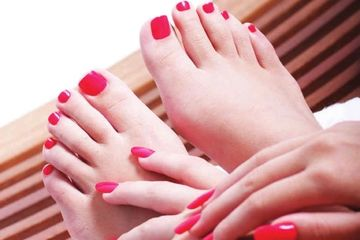 Beautiful Manicure and Pedicure in Pillarbox Red