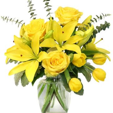 Spring flowers, yellow roses, tulips, lilies