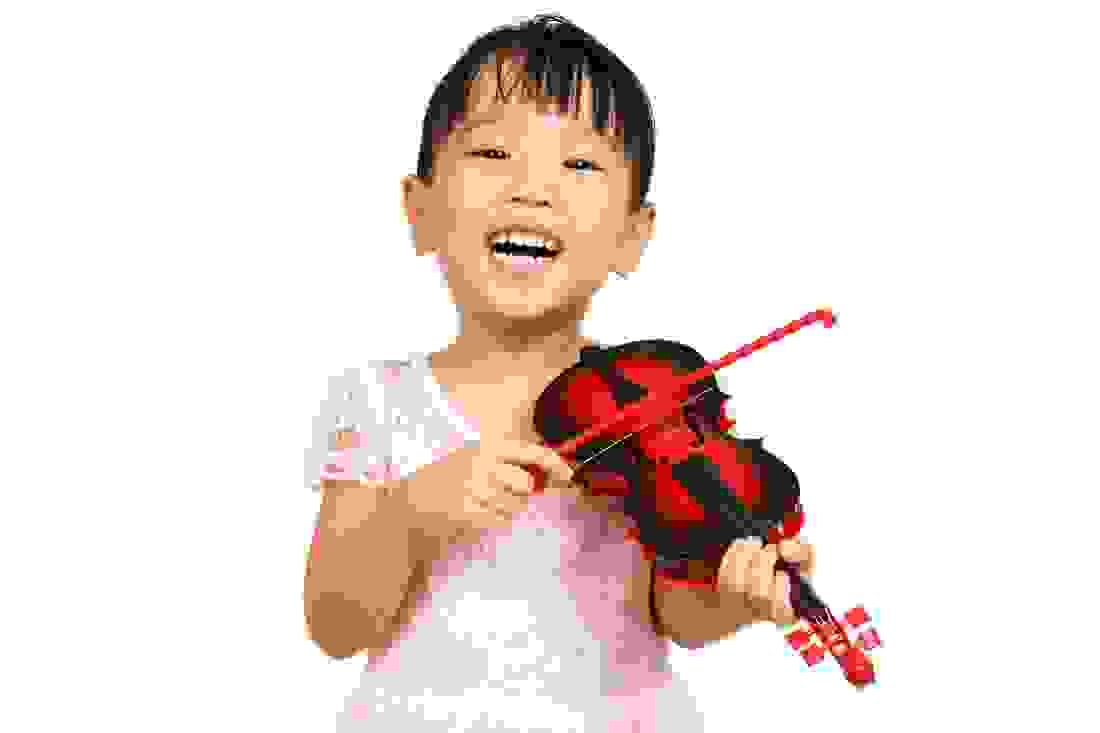 Young child learning violin