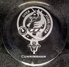Clear glass paperweight with laser engraved family crest