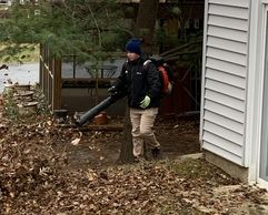 Our crew, blowing leaves in the fall for residential clients in St. Louis Metro