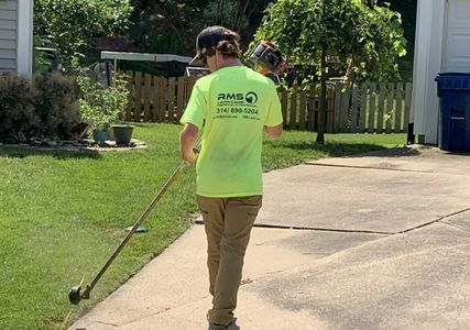 Our crew, trimming and edging for a residential clients