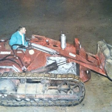 Jake Shroyer and his first dozer in 1950.