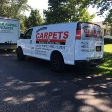Company van used to install carpet in the Iowa City, North Liberty, Cedar Rapids