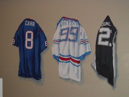 Realistic mural painting of team jerseys for a baby boy's nursery wall in Cypress, Texas.
