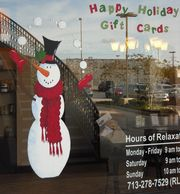 Our Houston window painter created this  snowman  for a Massage Heights in the River Oaks area.