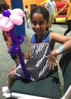 Houston birthday party hired our face paint & balloon artist to paint on her arm and make a balloon
