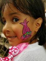 Little girl at a birthday party gets a troll painted on her face by our artist in Houston